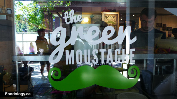 green-mustache-window
